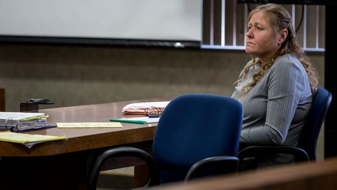 Judy Higley-Zueklke listens during opening statements Wednesday, Jan, 4, 2017 at the St. Clair County Courthouse in Port Huron. Higley-Zueklke, who was convicted of second-degree murder in the death of John Allen in 2014, is facing a second trial in light of new DNA evidence.