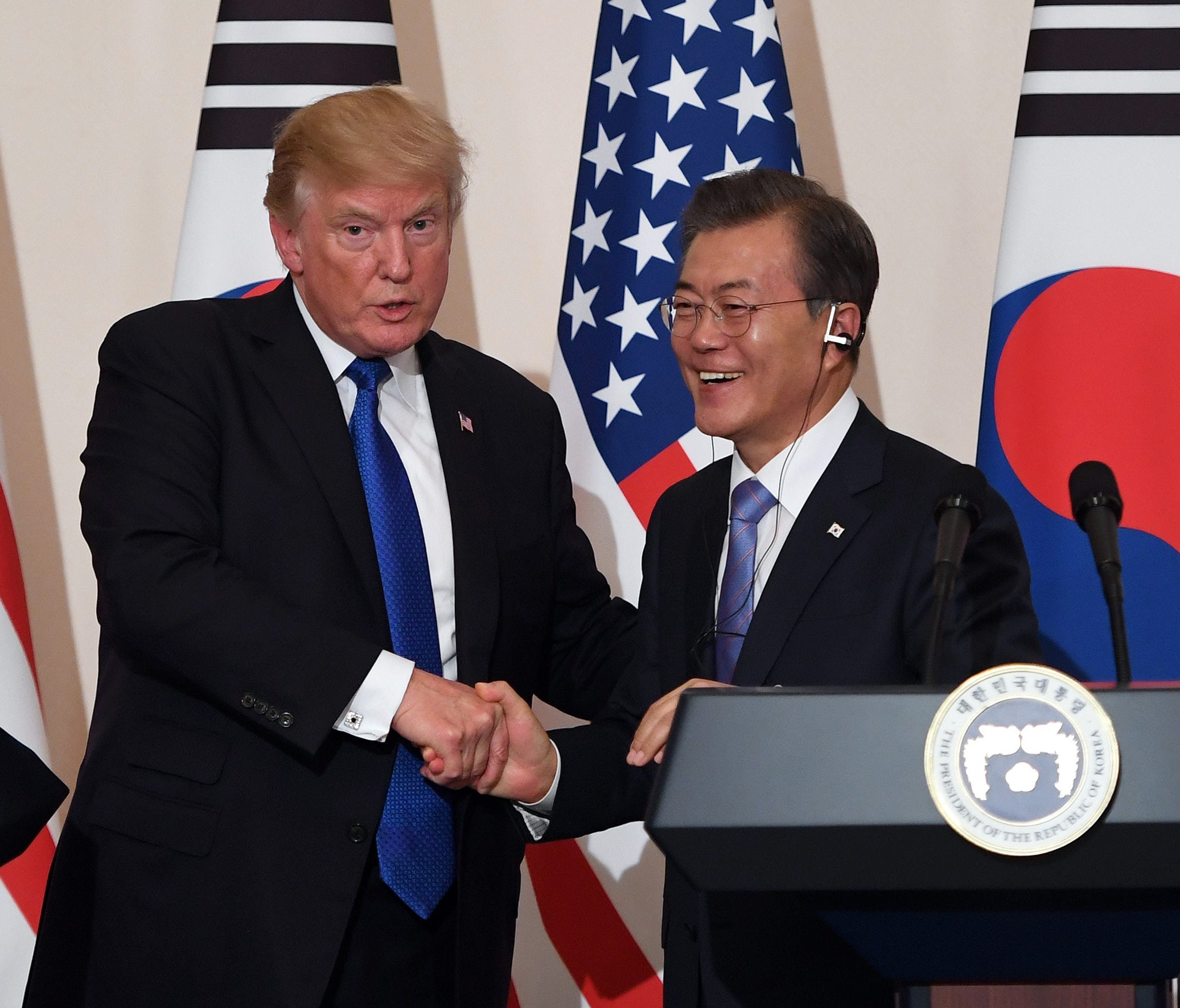 President Trump (L) shakes hands with South Korean President Moon Jae-In (R) during a joint press conference at the presidential Blue House in Seoul on Nov. 7, 2017.
