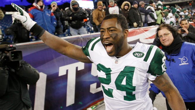 Darrelle Revis celebrates the Jets' 28-21 win against the Patriots in a divisional playoff game in Foxborough, Mass., in January 2011.