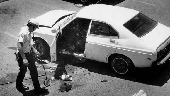 Police investigate Arizona Republic reporter Don Bolles' car after a remote-controlled bomb exploded beneath it on June 2, 1976. Bolles died 11 days later.  (Gazette photo by Nancy Engebretson)