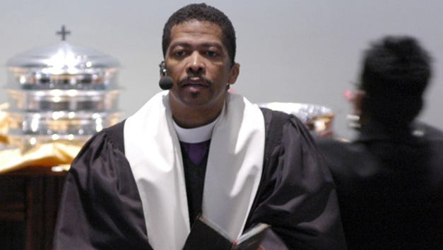 Rev. Jeffery Stallworth leads the congregation of the Word and Worship church in communion during grand opening services in Jackson, Miss.