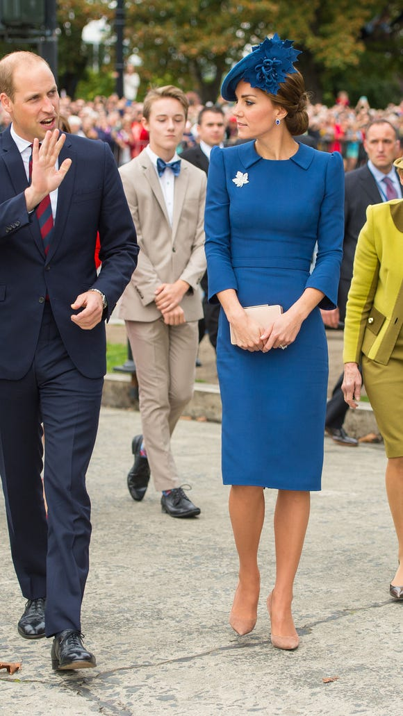 She topped her peacock-blue dress by Jenny Packham with a matching blue hat by Locke & Co.