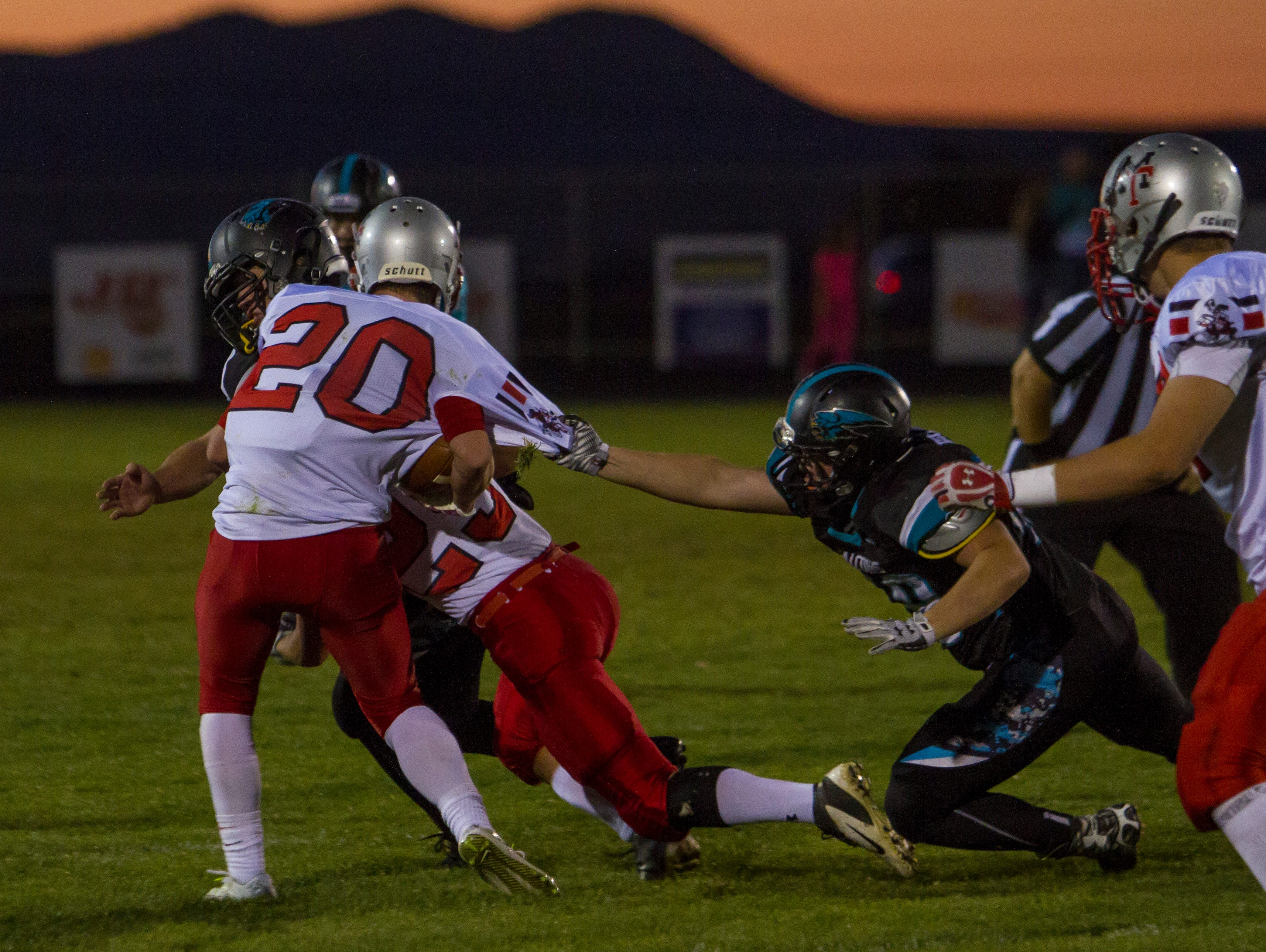 Canyon View's Tyler Buchanan (#48) makes a tackle against Manti, Friday, Sept. 18, 2015.