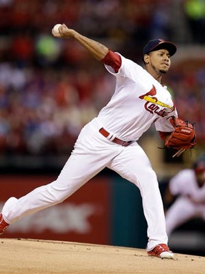 St. Louis Cardinals starting pitcher Carlos Martinez throws during the first inning of a baseball game against the Chicago Cubs Sunday, June 28, 2015, in St. Louis. (AP Photo/Jeff Roberson)