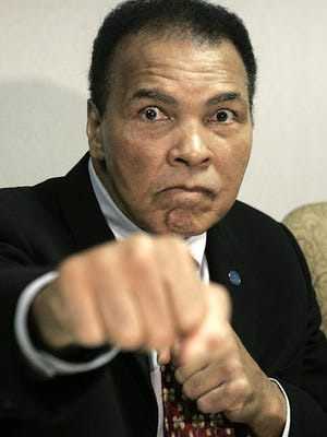 FILE - This is an Oct. 4, 2006, file photo showing Muhammad Ali posed in Detroit. The Muhammad Ali Center in Kentucky says it's planning a four-day celebration early next year to coincide with what would have been the boxing great's 75th birthday. The community activities at the downtown center in Ali's hometown of Louisville will start Jan. 14 and continue through Ali's birthday on Jan. 17.