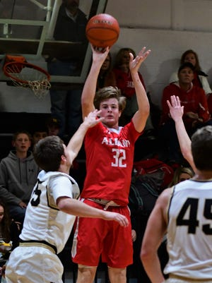 Albany's Ryan HIll fires a jumper over Rocky Haggard during AHS' 43-38 win at Haskell in a district game on Feb. 6, 2018 in Haskell.