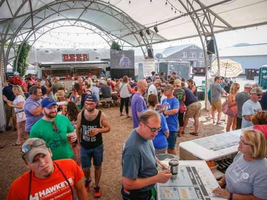 Fairgoers enjoy the Iowa Craft Beer Tent during the