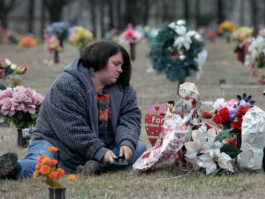 Amy Pittman visits the grave of her son, Christian,