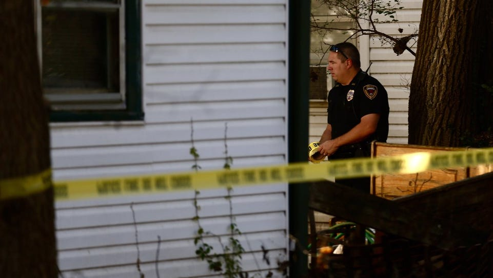 Police investigate the scene of a stabbing Monday in