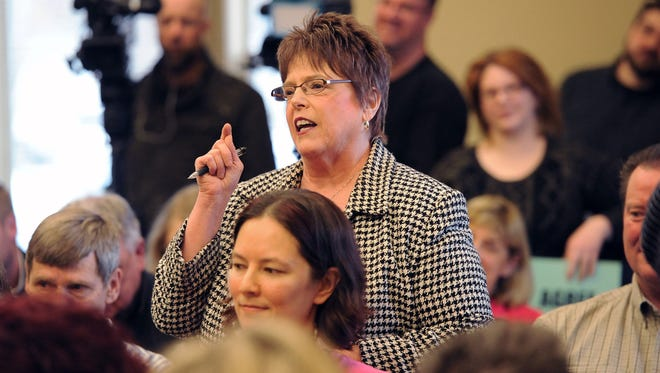 Mary Ellen Heywood of Menomonee Falls questioned Republican U.S. Rep. James Sensenbrenner questions about Planned Parenthood and other issues during the congressman's town hall in Pewaukee Saturday. Seventy people attended and another 100 were turned away because of lack of space.