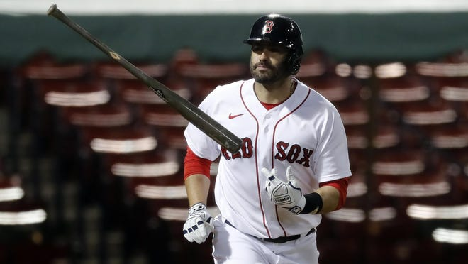 Boston Red Sox's J.D. Martinez, shown on Sept. 5 in a game against the Toronto Blue Jays, says he's leaning toward opting-in to the final two years of his contract this offseason.