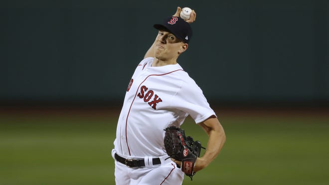 Boston Red Sox pitcher Nick Pivetta readies to throw against the Baltimore Orioles Tuesday night at Fenway Park.