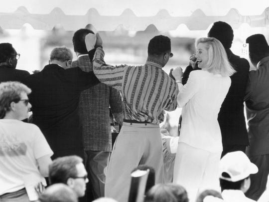 July 4, 1991 - Actress Cybill Shepherd shares a laugh with fellow actor Blair Underwood as they and a host of other dignitaries join in singing songs from the 1960s civil rights movement at the dedication of the National Civil Rights Museum in Memphis. (Michael McMullan/The Commercial Appeal files)