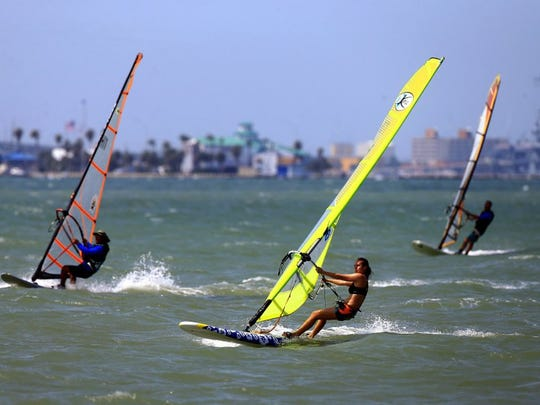 GABE HERNANDEZ/CALLER-TIMES Margot Samson (center) rides the waves during the U.S. Windsurfing National Championships on Wednesday, May 11, 2016, at Oleander Point in Cole Park in Corpus Christi.