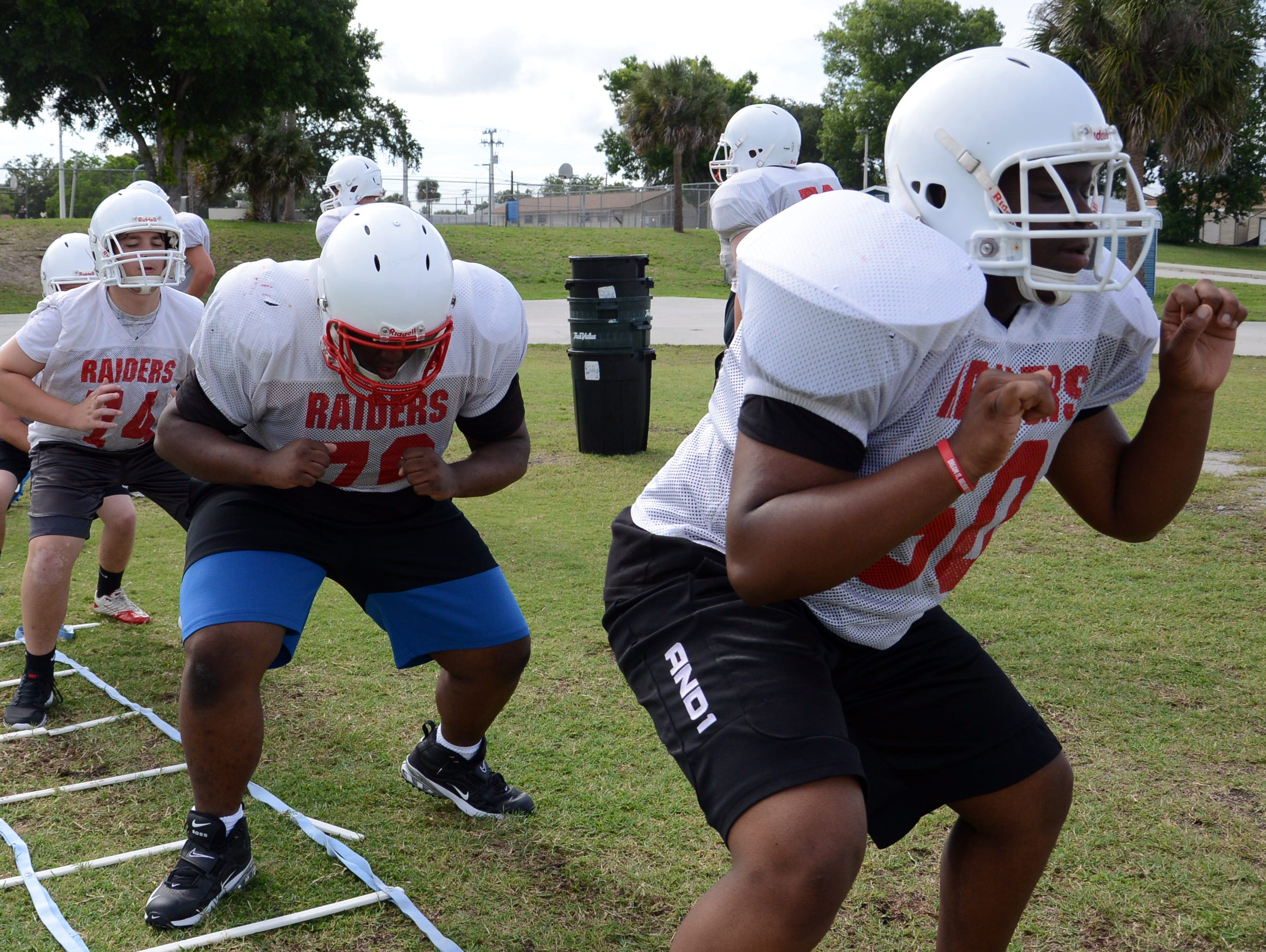 Players run through agility drills during a recent practice at Rockledge High School.