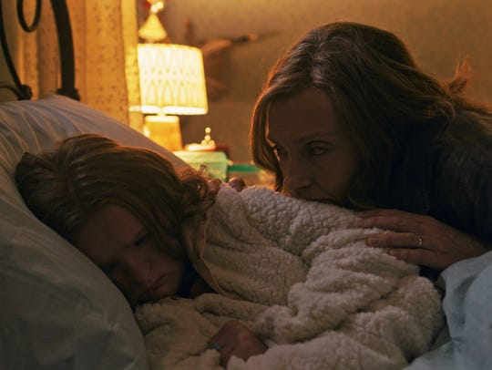 Annie (Toni Collette, right) watches over her daughter
