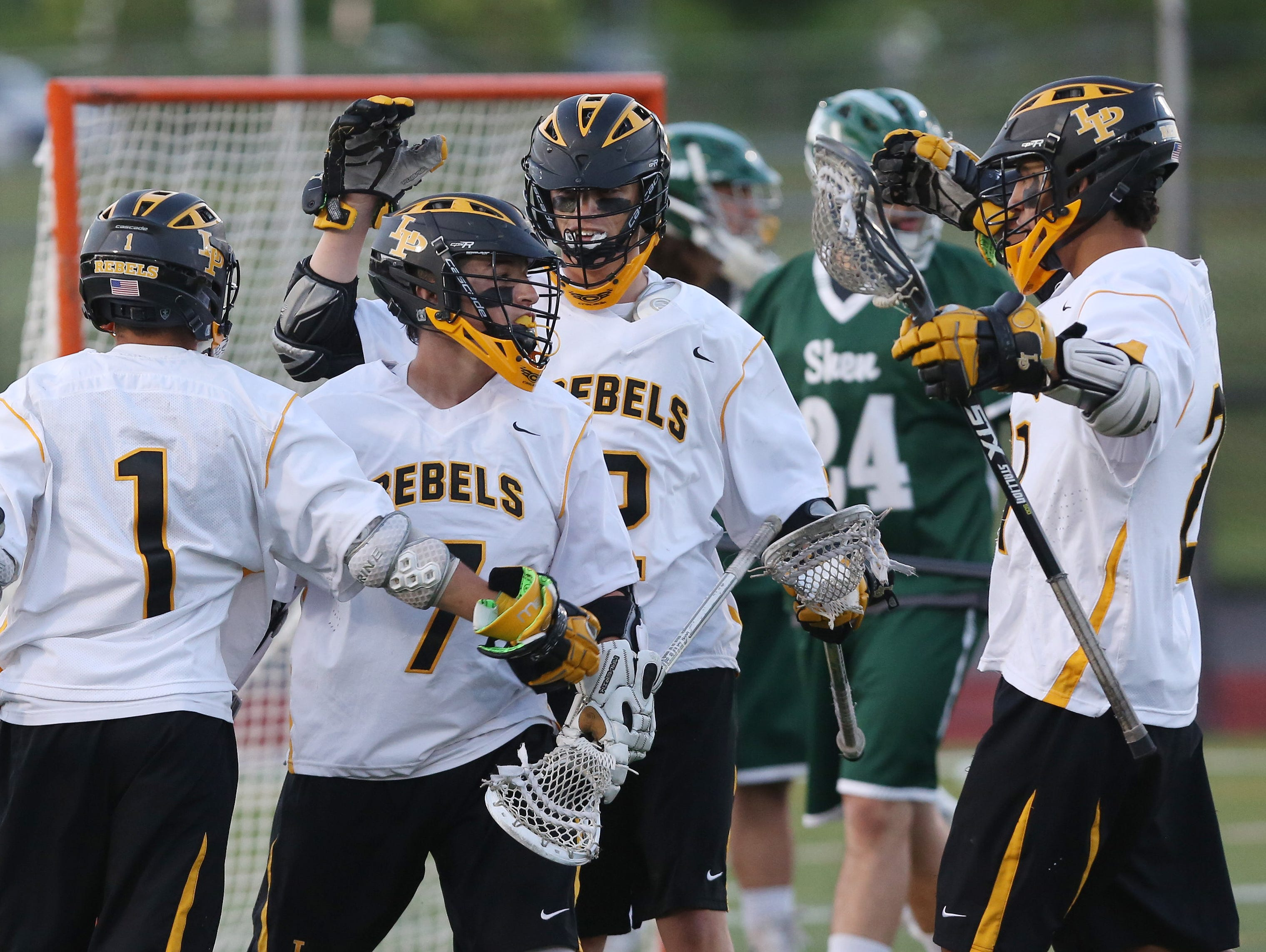 Lakeland/Panas players celebrate with Jo Jo Janavey (7) after his goal against Shenendehowa in the Class A state regional semifinal lacrosse game at Yorktown High School June 1, 2016. Lakeland/Panas won the game 8-7.