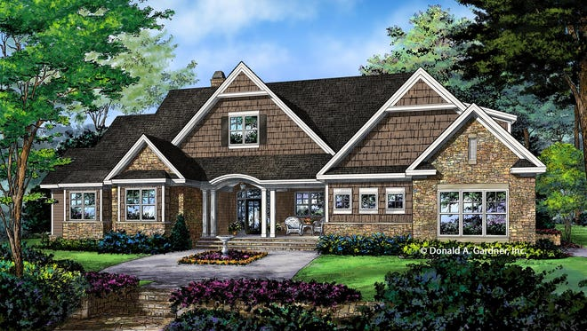Shingle and stone create an exterior with Craftsman curb appeal.