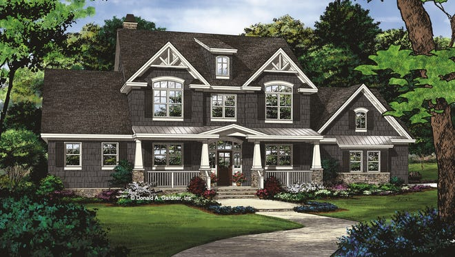 Elegant tapered columns add Craftsman flair, while twin gables with a single center dormer contribute farmhouse style.