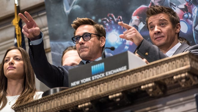 Actors Robert Downey Jr., left, and Jeremy Renner ring the NYSE opening bell on Monday.