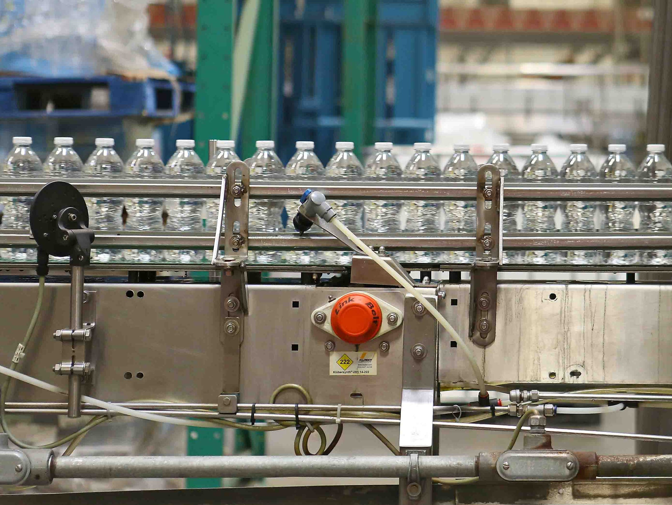 Bottles of water move on a conveyor belt at the Nestle