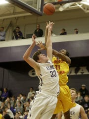 Elder High School graduate and basketball standout Ryan Custer in action during a 2015 game.