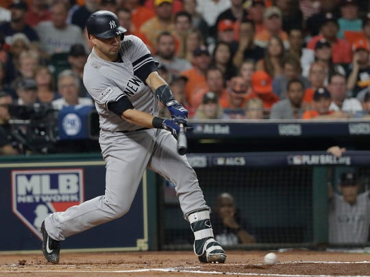 New York Yankees' Gary Sanchez hits a single during the second inning of Game 7 of baseball's American League Championship Series against the Houston Astros Saturday, Oct. 21, 2017, in Houston.