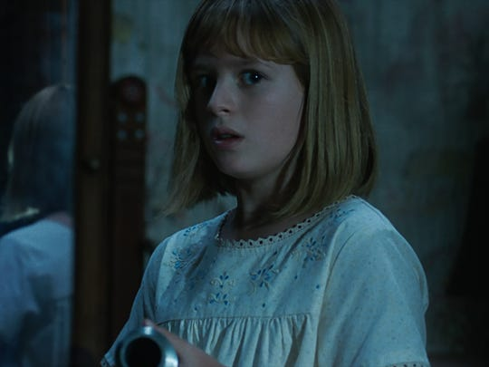 """The Annabelle doll and Lulu Wilson as Linda in supernatural thriller """"Annabelle: Creation."""""""