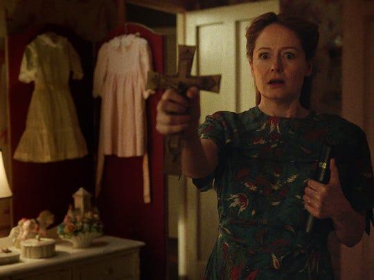 "Miranda Otto tries to ward off evil in ""Annabelle: Creation."""