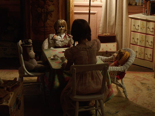 "The Annabelle doll invites you  to tea in ""Annabelle:"