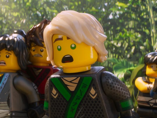 "Lloyd (center, voiced by Dave Franco) and his friends must save the day and defeat Lloyd's dad in ""The Lego Ninjago Movie."""