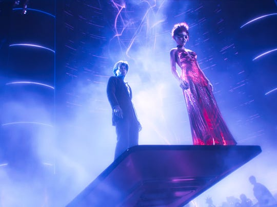 """Parzival and Art3mis meet in the OASIS virtual world at a dance club in """"Ready Player One."""""""