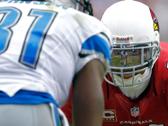 Detroit Lions wide receiver Calvin Johnson is reflected