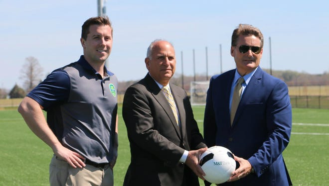 M&T Bank bought the naming rights to one of 12 fields at DE Turf near Frederica. Pictured are (from left) Chris Giacomucci, executive director of the DE Turf Sports Complex, Nick Lambrow, Delaware regional president for M&T Bank and Bill Strickland, president of DE Turf's board of directors.
