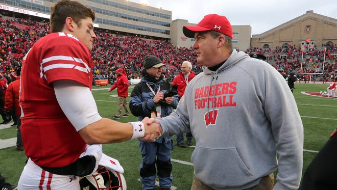 UW coach Paul Chryst congratulates quarterback Alex Hornibrook after the Badgers' 24-10 victory over Michigan Saturday at Camp Randall Stadium.