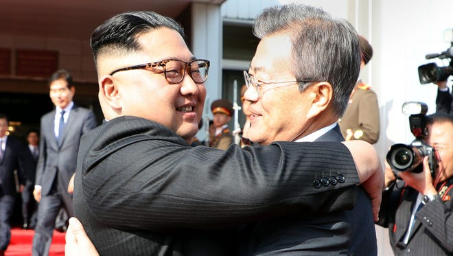 This picture taken on May 26, 2018 and released by the Blue House via Dong-A Ilbo shows South Korea's President Moon Jae-in, right,  hugging North Korea's leader Kim Jong Un after their second summit at the north side of the truce village of Panmunjom in the Demilitarized Zone. South Korea said President Moon Jae-in met with North Korea's leader Kim Jong Un on May 26 inside the Demilitarised Zone dividing the two nations, a day after US President Donald Trump threatened to abandon a summit with Pyongyang.