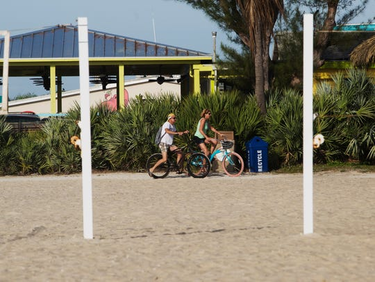 Bicyclists use the public access at Crescent Beach
