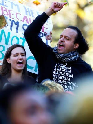 Purdue University gradate student Don Guillermo chants along with students during a demonstration outside the Class of 1950 Lecture Hall in West Lafayette on Friday, November 13, 2015.