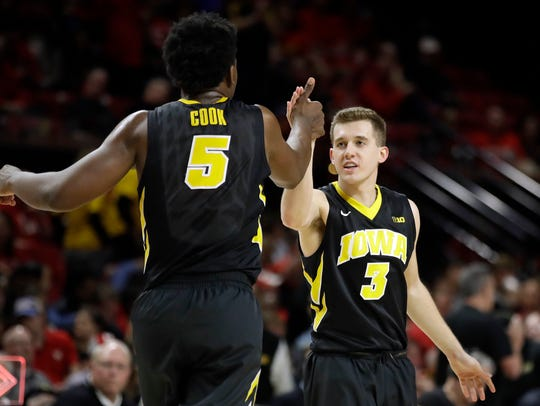 Iowa guard Jordan Bohannon, right, high-fives forward