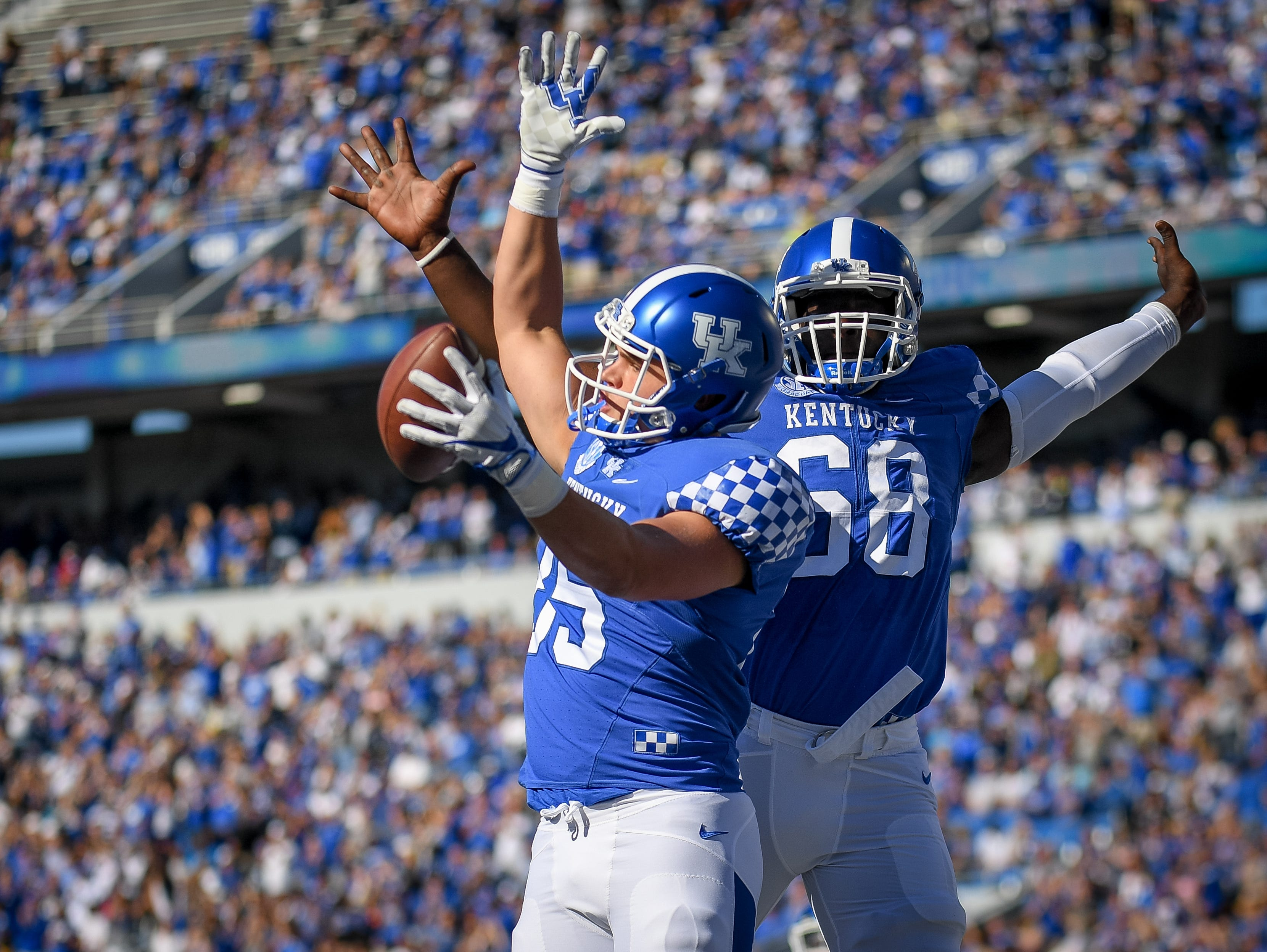 Kentucky Wildcats tight end Greg Hart (85) and Kentucky Wildcats guard Nick Haynes (68) celebrate after a touchdown during the first half of the game against the Eastern Michigan Eagles at Kroger Field on the campus of TheUniversity of Kentucky in Lexington, Ky, Saturday, September 30, 2017.
