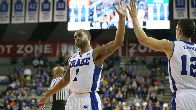 Drake's Karl Madison gives a high-five to teammate Reed Timmer on Sunday, Feb. 22, 2015 at the Knapp Center. The Drake Bulldogs beat the Missouri State Bears 78-43 on senior night.