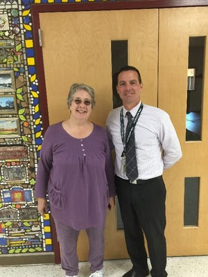 Buckshutem Road School Principal Derek Macchia and media specialist Lugene Trefsger stand in front of the school library, which recently was remodeled. The library improvements will continue as the school received a 2016 Laura Bush Foundation for America's Libraries grant in May.