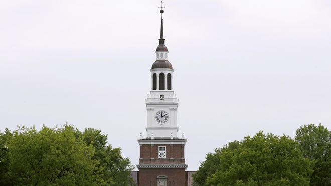 The spire of the Baker-Berry Library stands above The Green at Dartmouth College in Hanover. The college announced undergraduate students will begin returning to campus Sept. 8.