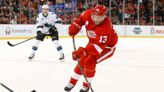 Detroit Red Wings' Pavel Datsyuk shoots against the San Jose Sharks in the second period of an NHL hockey game Friday, Nov. 13, 2015 in Detroit.
