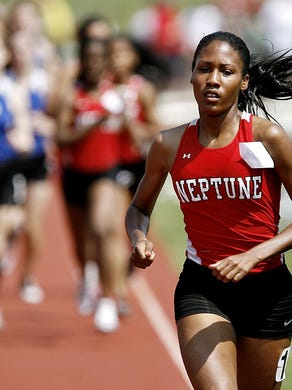Neptune's Ajee Wilson leads the field in the girls 800 at the NJSIAA Central Jersey Group II and III sectionals in 2012.