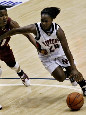 (PSports) 1/16/2011, West Long Branch - Neptune's Shakena Richardson brings the ball in against Christ The King's Nia Oden during the Boardwalk Hoop Group Showcase at Monmouth University.......Mike McLaughlin/Special to the Press