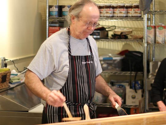 Oregon Crepe Cafe & Bakery owner Richard Foote prepares crepes for customers.