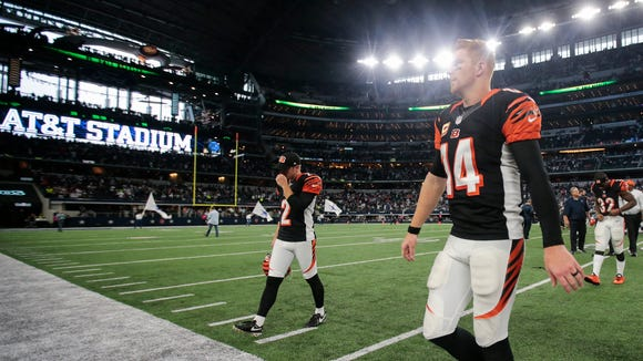 Bengals quarterback Andy Dalton walks off the field after Sunday's loss to the Dallas Cowboys.