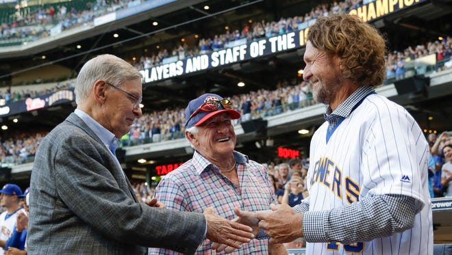 Former baseball commissioner Bud Selig and radio announcer Bob Uecker shake hands with former Brewer Robin Yount before the game at Miller Park between the Brewers and Phillies.