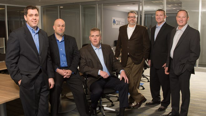 Global Data Consultants executives, from left to right, Michael Coons, Dan Logan, Gregory Courtney, Thomas Trgovac, Jeff Sauve and Dennis Coons.